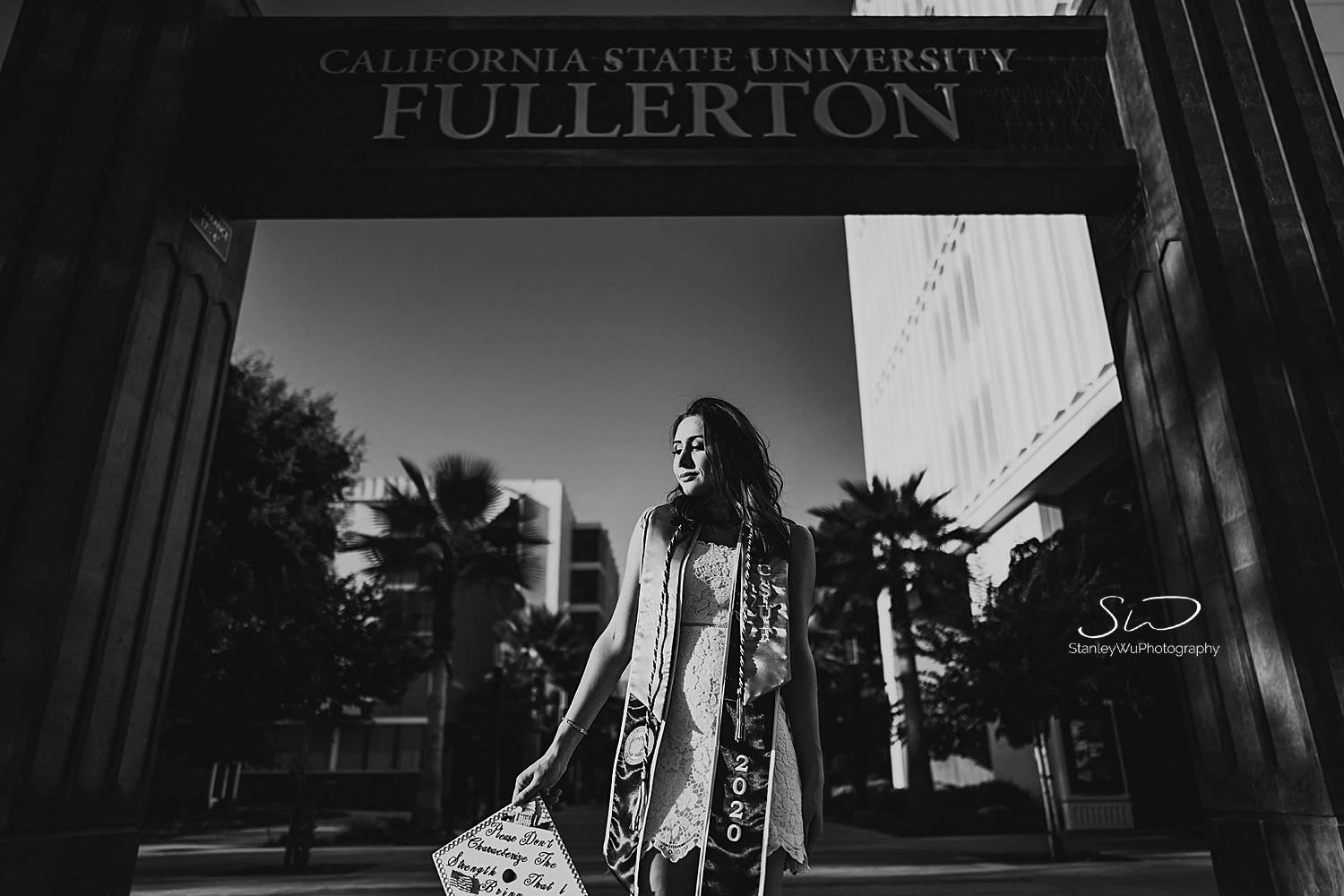 csu fullerton graduation photos dramatic epic shot in front of the sign