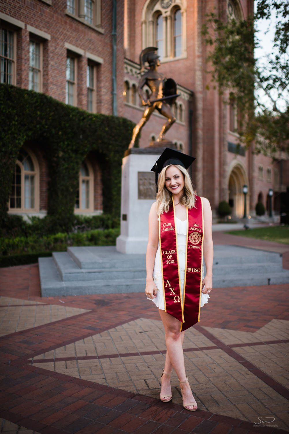 graduating senior standing in front of tommy trojan statue | usc graduation photographer los angeles